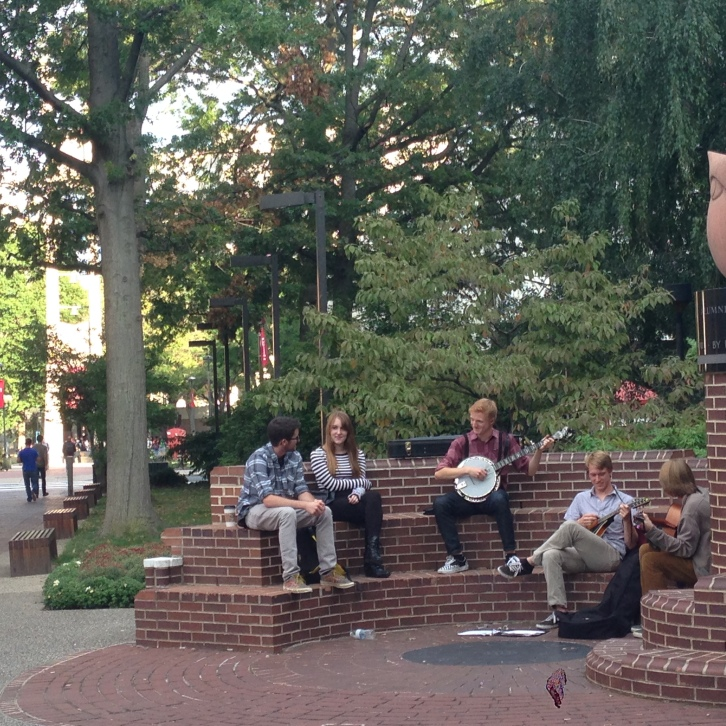 Students gather around Alumni Circle at Temple University to play music.